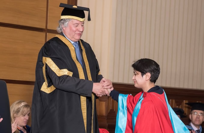 Picture of Vice Chancellor Sir Adrian Smith conferring honorary degree on Baroness Charkrabarti in 2016